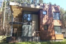 Дом облицовка фасада натуральным камнем с колонами