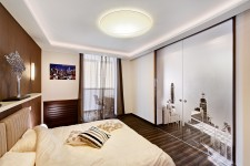 Спальня светлая стильная квартира-студия