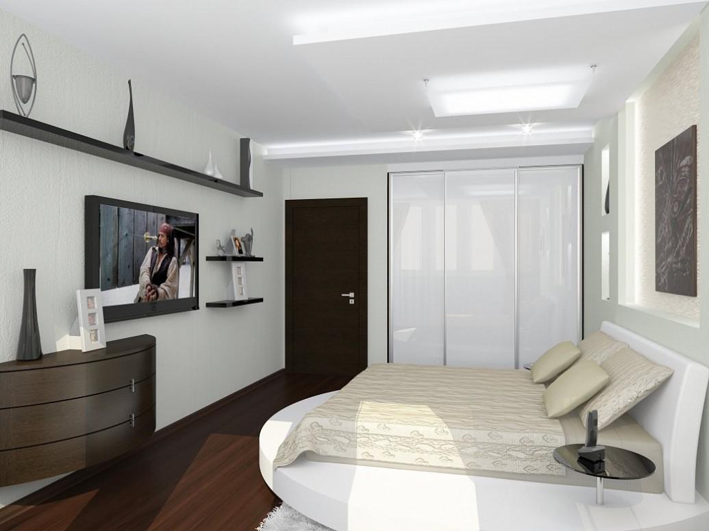 Белая кровать-подиум спальни квартиры-студии